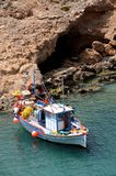 Fishing boat. Old fishing boat at the natural port in Crete, Greece Stock Photos