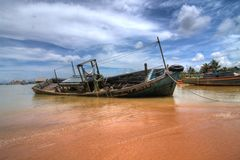 Fishing Boat. HDR landscape view of a fishing boat in a fishing village off the coast of Malaysia Stock Photos