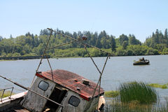 Fishing boat abandoned on shore in Reedsport, Oregon Stock Photos