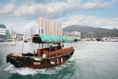 Fishing boat in Aberdeen harbor in Hong Kong Royalty Free Stock Photo