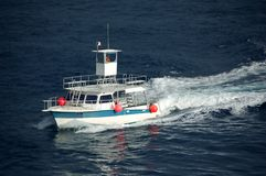 Fishing boat afloat Stock Image