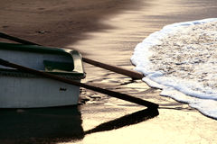 Fishing boat afternoon. Exiting water in a beach Stock Images