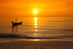 Fishing boat against abated sunshine. Landscape from the coast of gulf of Thailand Royalty Free Stock Photo