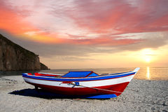 Fishing boat against sunset Royalty Free Stock Images