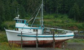 Fishing boat aground. Fishing boat is Hard Aground, needs repairs royalty free stock image