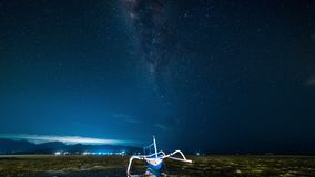 The fishing boat is aground against the background of the milky way timelapse stock video