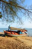 Fishing boat aground. On the beach Stock Photos