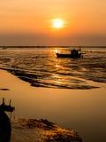 Fishing boat aground. Sunset light Stock Image