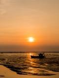 Fishing boat aground. Sunset light Royalty Free Stock Photo