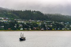 Fishing Boat motoring in Alaska royalty free stock photography