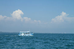 A fishing boat alone Stock Images