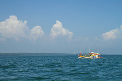 A fishing boat alone Royalty Free Stock Images