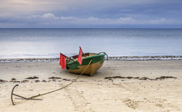 Fishing boat with anchor and flags Royalty Free Stock Photos
