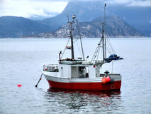 Fishing boat on anchor in haven. Fishing cutter on anchor in a small harbor Stock Image