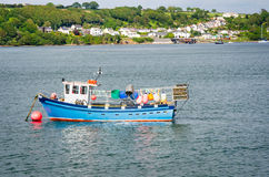 Fishing Boat Anchored in Harbour Stock Photo