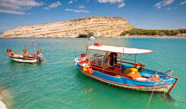 Fishing boat anchored in Matala bay, Crete Royalty Free Stock Photos