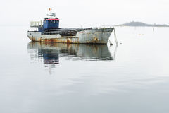 Fishing boat anchored in the middle of the sea Royalty Free Stock Photos