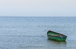Fishing boat anchored near a beach Royalty Free Stock Image
