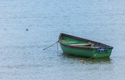 Fishing boat anchored near a beach Royalty Free Stock Images