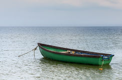 Fishing boat anchored near a beach Royalty Free Stock Photo