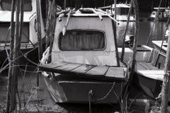 Fishing Boat Anchored at Rivers Shore royalty free stock photo