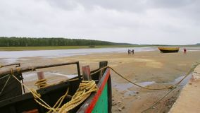 Fishing boat anchored at sea coast. A fishing boat anchored at Digha beach side after fishing for business,West Bengal,India stock footage