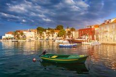 Fishing boat anchoring in beautiful Sutivan port, Brac island, Croatia. Sutivan on Island Brac in Croatia. Made of well known. White limestone. Port with royalty free stock photos
