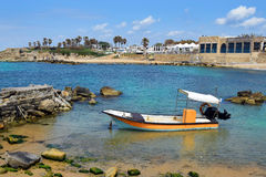 Fishing boat at ancient port Caesarea, Israel. Fishing boat at ancient port Caesarea, built by the Crusaders during the Crusades, Israel royalty free stock photo