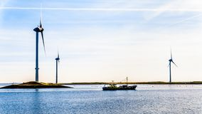 Fishing Boat And Wind Turbines At The Oosterschelde Inlet At The Neeltje Jans Island In Zeeland Province In The Netherlands Royalty Free Stock Photos