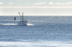 Fishing boat approaching Cape Cod Canal Royalty Free Stock Photo