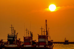 Fishing boat aprking at sea port. Fishing boats are parking at sea port during sunset Royalty Free Stock Photography