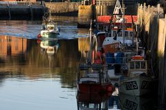 Fishing boat arrives at Padstow harbour stock images