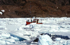 Fishing boat in artic sea Stock Images