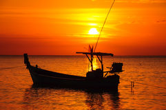 Fishing Boat At Beach And Sunset Stock Photo