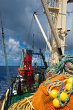 Fishing boat in atlantic ocean royalty free stock photo