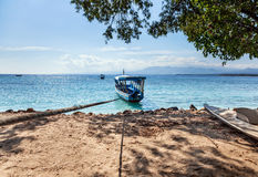 Fishing boat on the azure shore Royalty Free Stock Photo