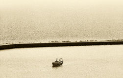 Fishing boat, back to the harbour, sepia hue Royalty Free Stock Photos