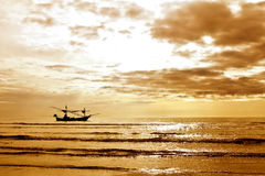 Fishing boat on a background of a beautiful sunset Royalty Free Stock Photos