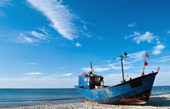 Fishing boat on the Baltic beach Royalty Free Stock Photos