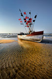 Fishing boat on the Baltic beach Stock Photography