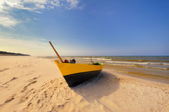 Fishing boat on the Baltic beach Royalty Free Stock Photo