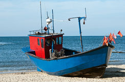 Fishing boat at baltic sea coast Stock Photos