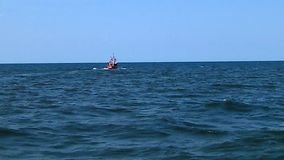 Fishing boat in the Baltic Sea stock video footage