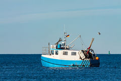 Fishing boat on the Baltic Sea in Warnemuende Stock Photos