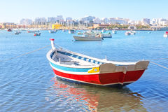 Fishing boat in the bay of Ferragudo . Portugal. Stock Photos