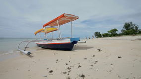Fishing boat. In bay on Gili Air island of Bali, Indonesia stock footage
