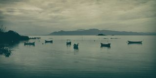 Fishing boat in the bay on a grey day royalty free stock image