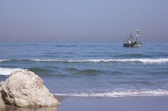 Fishing boat and beach Stock Photos