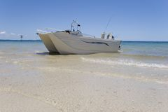 Fishing boat on beach. A fishing boat landed on beach on fraser island Royalty Free Stock Images