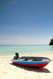 Fishing Boat at Beach. With clear water during vacation royalty free stock photo